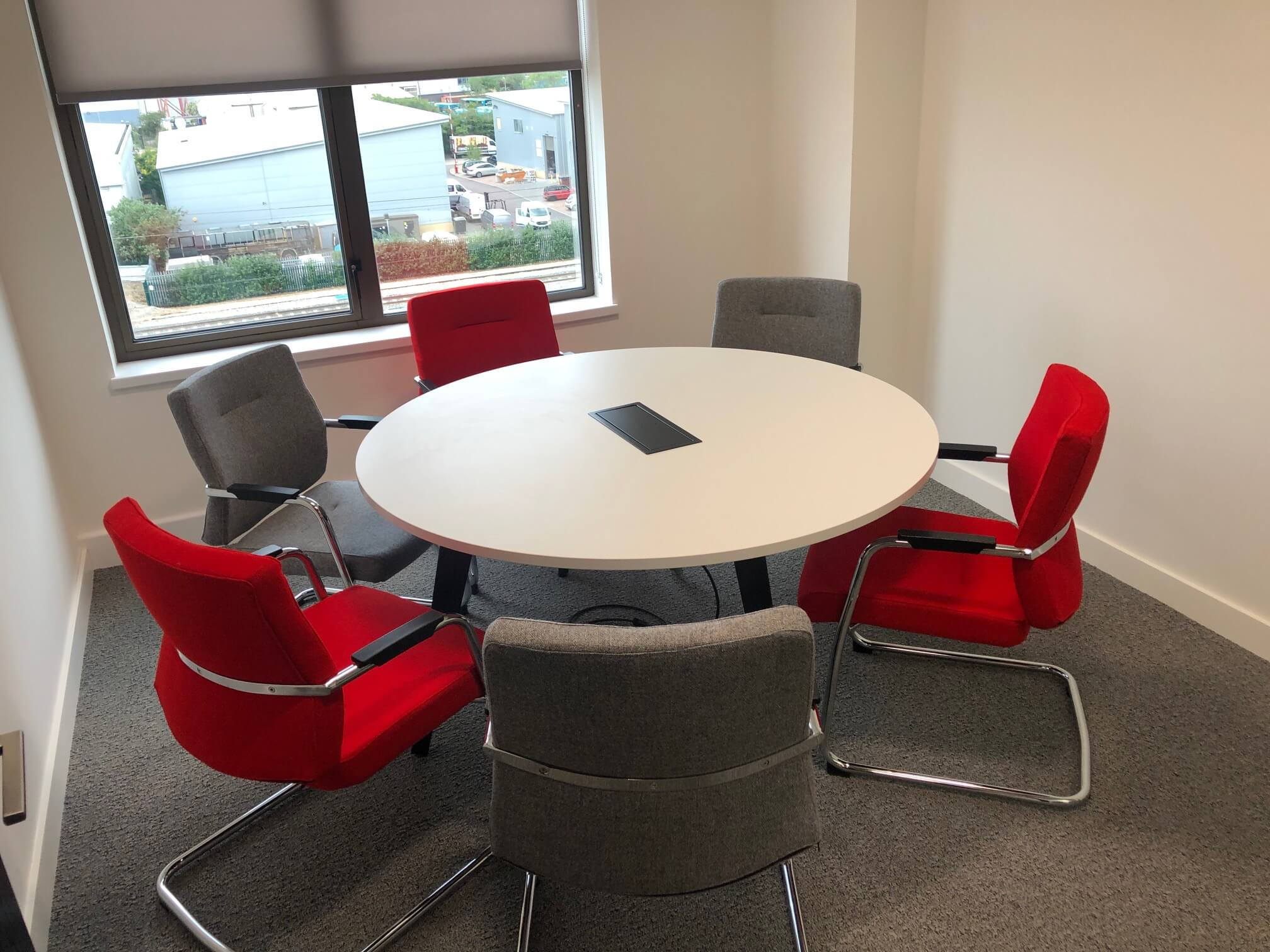 small grey and red office chairs